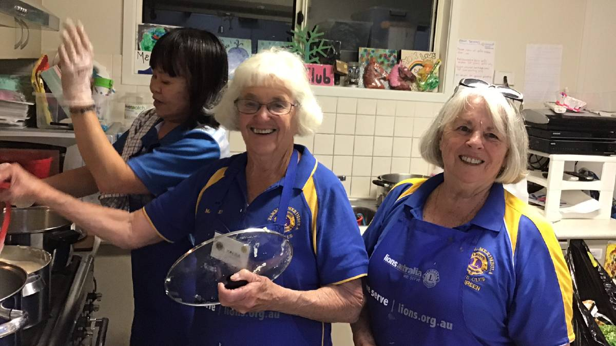 From left: Dara, Valda and Maureen from the Lions Club of Pambula Merimbula preparing dinner for the Rolling Solo event on Saturday May 2. Pictures: supplied.