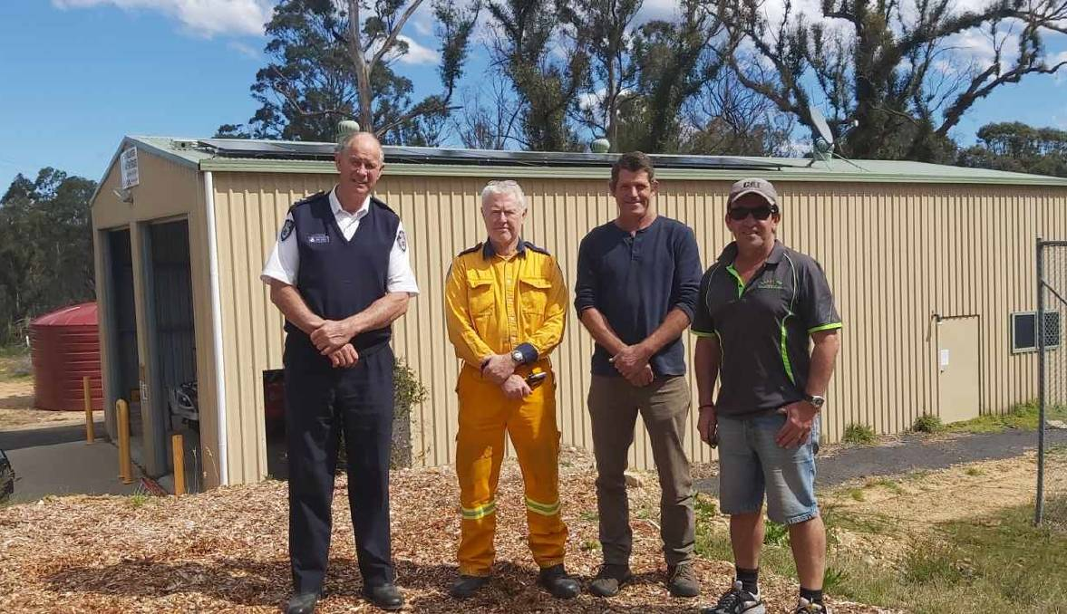 WELCOME DONATION: Celebrating the installation of solar panels on Kiah's fire shed are RFS Superintendent John Cullen, the fire brigade's Jeff Browning, CEFE's Derek Povel and Lakeside Electrical's Paul Palacios. Picture: Supplied