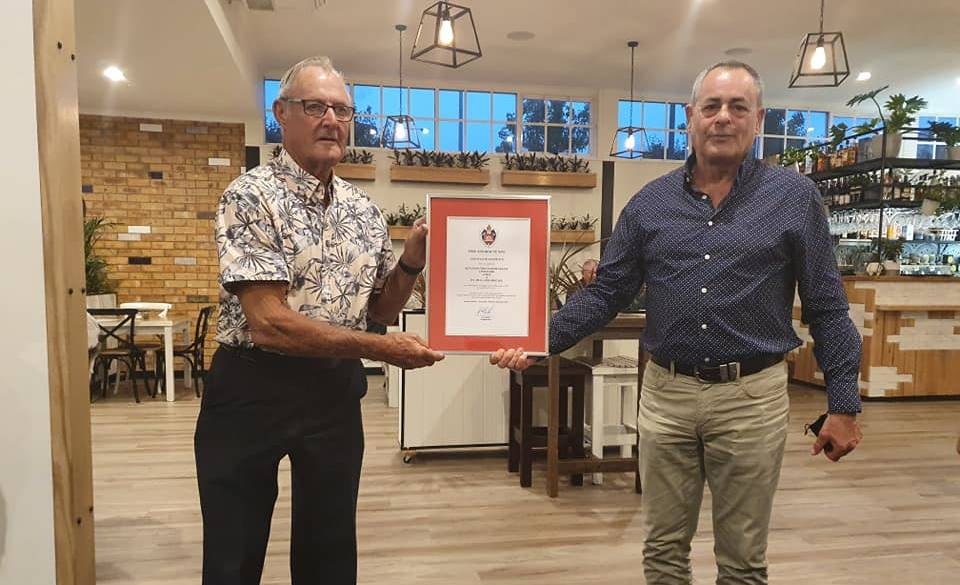 Ernie Vinecombe is congratulated by Assistant Commissioner Rob McNeil for serving the community for 52 years in Fire and Rescue NSW. Picture: Fire and Rescue NSW Station 219 Bega Facebook page