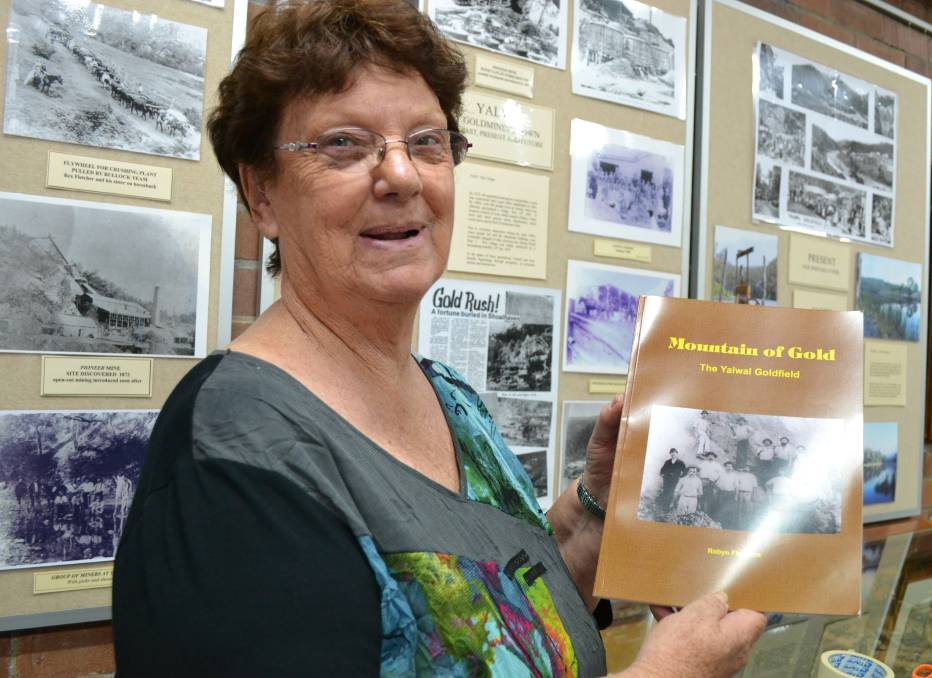 GREAT STORY: Shoalhaven historian Robyn Florance with her her latest book, Mountain of Gold about local gold mining town Yalwal.