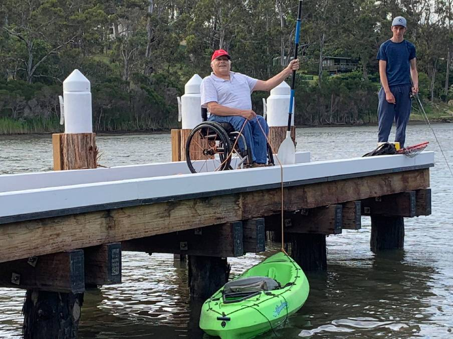 Kalaru's Chris Sparks shows the height disparity for jetty users who might want to launch a kayak.