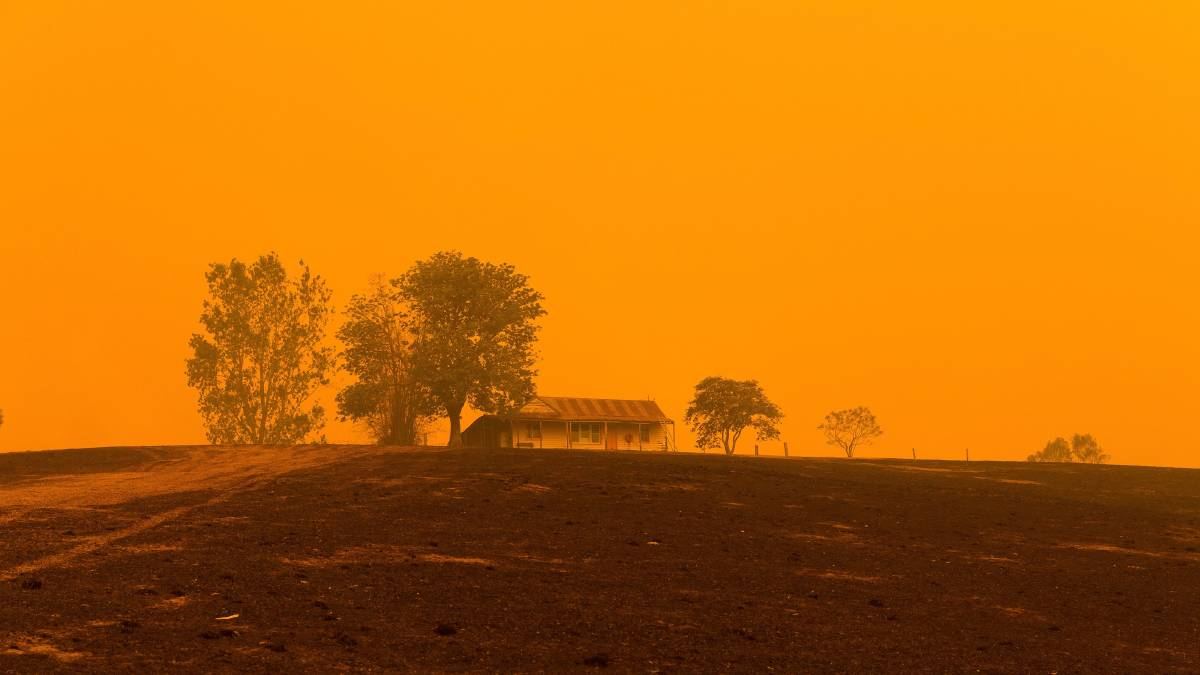 Familiar: The ominous orange skies that were common during the 2019-20 bushfires loom over a property near Cobargo. Picture: Ben Marden Photography.