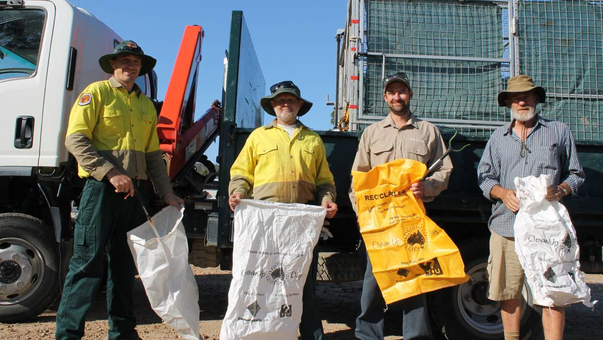 NPWS staff Simon Conaty and Darryl Bills, Luke Brown of the Bournda Environmental Education Centre and community volunteer Bob Brown during their clean-up of Sapphire Coast Drive last March.